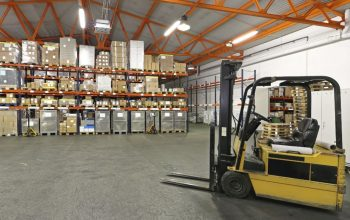 Forklift in front of shelving system at warehouse